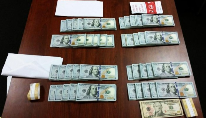 U.S. Money Seized by Customs (CBP) Stacked on a Table with Envelopes