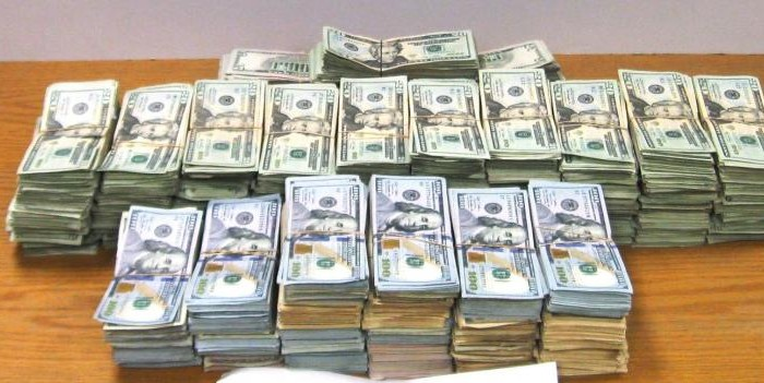 Texas CBP seized cash. A picture of 19 stacks of $20 and $100 bills part of the cash seized by CBP at Hidalgo International Bridge