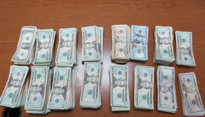 A overhead shot $43,000 mostly in $20 bills that was seized by U.S. Customs & Border Protection protection heading outbound to Mexico.