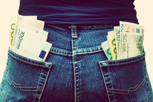 Customs seized cash at airport totaling $51,851, concealed in clothing.