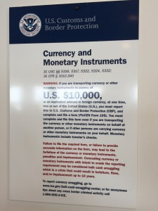 Picture of Detroit airport currency report sign.