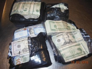 Unreported bulk cash seized by CBP wrapped in rubber bands and black plastic