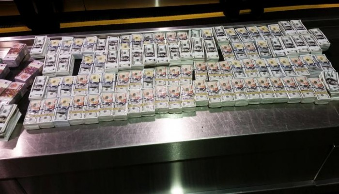 Stacks of Counterfeit $100 Bills that was part of the cash seizure at Detroit Metro Airport