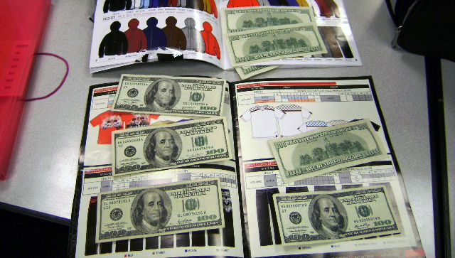 An image of cash lined within the pages of magazines seized by Chicago CBP at O'Hare airport