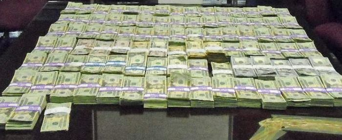 $211k Cash Seized by CBP laid out on a table in stacks