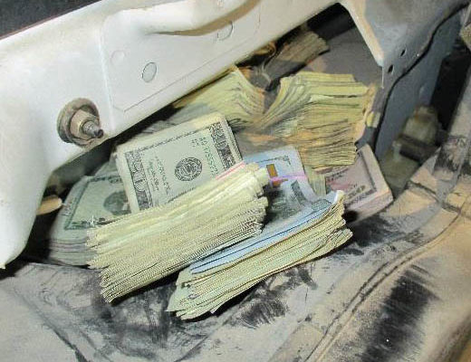 Bulk cash hidden in the vehicle panels seized by U.S. Customs & Border Protection