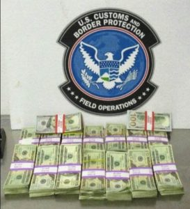 20 stacks of new U.S. currency seized by U.S. Customs & Border Protection for smuggling and failure to report cash to customs