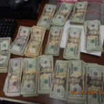 Stacks of bills totaling $16,152 in unreported currency seized by CBP officers at Eagle Pass Port of Entry.