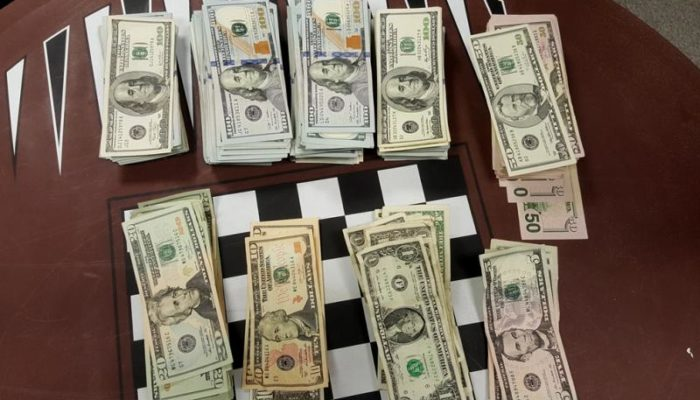 Piles of cash seized by CBP officers at Philadelphia airport.