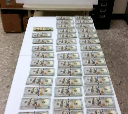 An image of cash seized by Customs at Dulles airport while traveling to Ghana