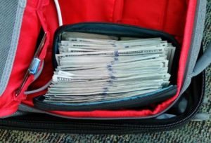 A backup full of $100 bills seized by Customs officers for failing to report cash at Dulles airport.