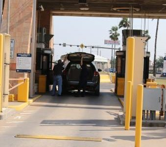 A CBP officer conducts a primary inspection at the SENTRI lane at Hidalgo International Bridge.