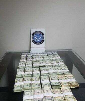 About $96,000 seized by CBP in Arizona laid out on table