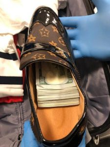 Stacks of $100 bills hidden in a shoe